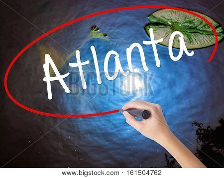 Woman Hand Writing Atlanta With Marker Over Transparent Board