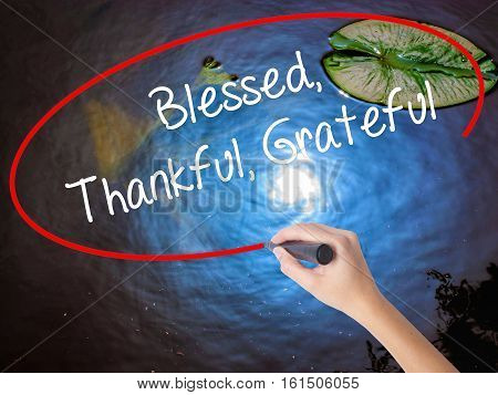 Woman Hand Writing  Blessed Thankful Grateful With Marker Over Transparent Board