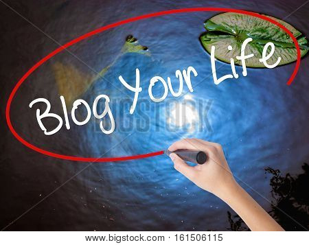 Woman Hand Writing Blog Your Life With Marker Over Transparent Board