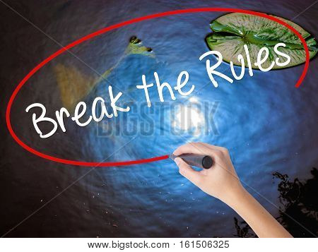 Woman Hand Writing Break The Rules With Marker Over Transparent Board