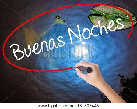 Woman Hand Writing Buenas Noches (good Night In Spanish) With Marker Over Transparent Board.