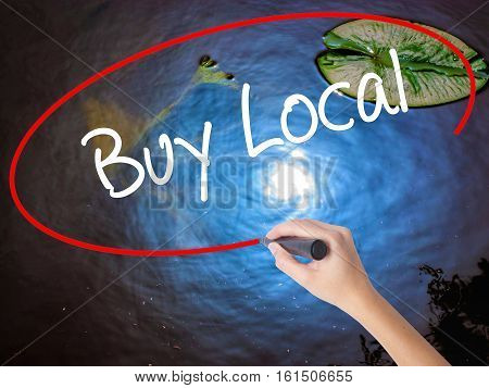 Woman Hand Writing Buy Local  With Marker Over Transparent Board