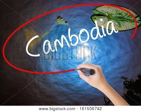 Woman Hand Writing Cambodia  With Marker Over Transparent Board