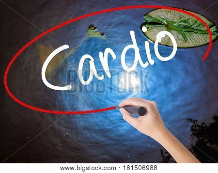 Woman Hand Writing Cardio With Marker Over Transparent Board