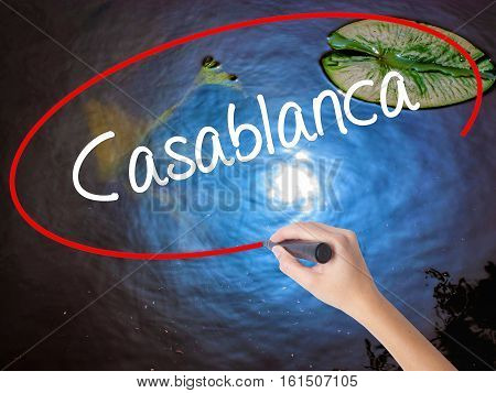 Woman Hand Writing Casablanca With Marker Over Transparent Board