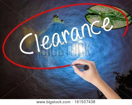 Woman Hand Writing Clearance  With Marker Over Transparent Board