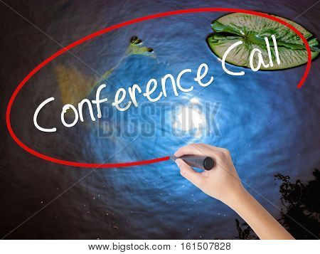 Woman Hand Writing Conference Call With Marker Over Transparent Board.