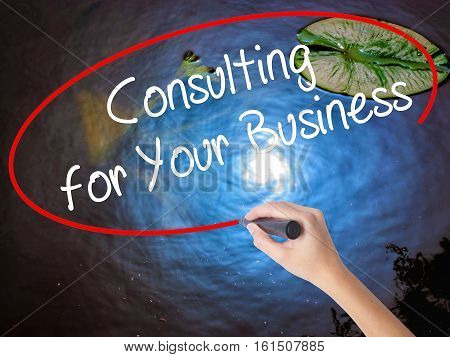Woman Hand Writing Consulting For Your Business With Marker Over Transparent Board