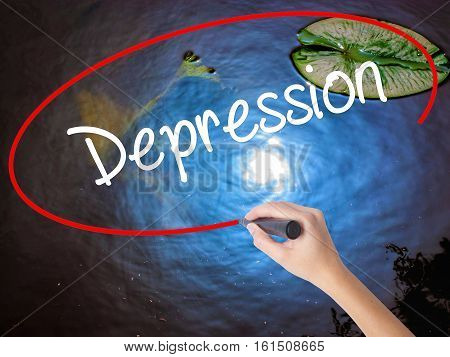 Woman Hand Writing Depression  With Marker Over Transparent Board