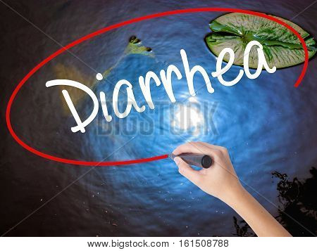 Woman Hand Writing  Diarrhea  With Marker Over Transparent Board