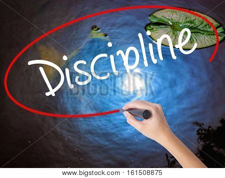 Woman Hand Writing Discipline With Marker Over Transparent Board