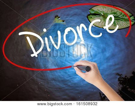 Woman Hand Writing Divorce  With Marker Over Transparent Board