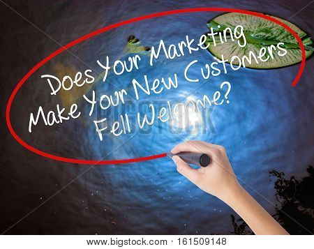 Woman Hand Writing Does Your Marketing Make Your New Customers Fell Welcome?  With Marker Over Trans