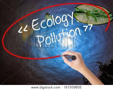 Woman Hand Writing Ecology - Pollution With Marker Over Transparent Board