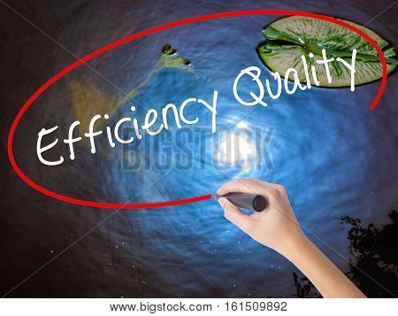 Woman Hand Writing Efficiency Quality  With Marker Over Transparent Board.