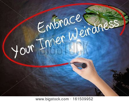 Woman Hand Writing Embrace Your Inner Weirdness  With Marker Over Transparent Board