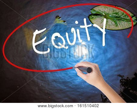 Woman Hand Writing Equity With Marker Over Transparent Board