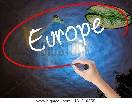 Woman Hand Writing Europe With Marker Over Transparent Board