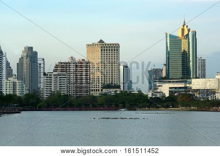 View of Building Skyline taken from Benjakiti Park in Bangkok,Thailand.