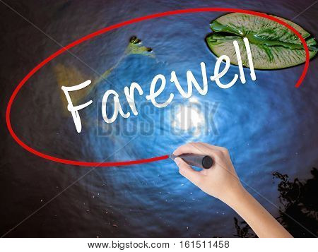 Woman Hand Writing Farewell  With Marker Over Transparent Board