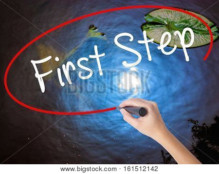 Woman Hand Writing First Step  With Marker Over Transparent Board