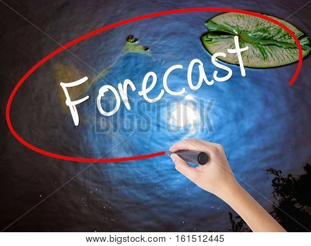Woman Hand Writing Forecast With Marker Over Transparent Board