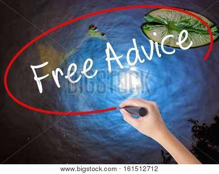 Woman Hand Writing Free Advice With Marker Over Transparent Board