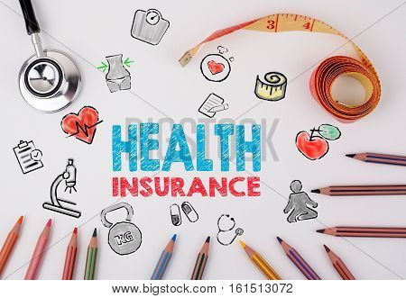 Health insurance concept. Healty lifestyle background.Stethoscope, pencils and tape measure on the table