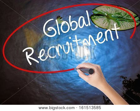 Woman Hand Writing Global Recruitment With Marker Over Transparent Board