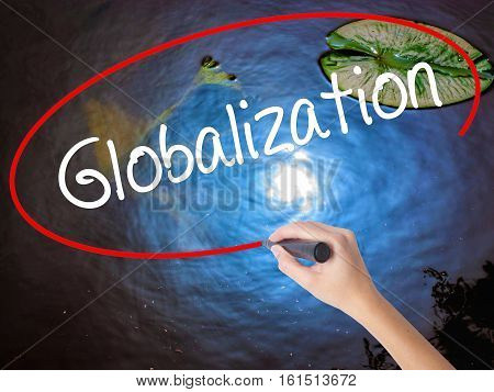 Woman Hand Writing Globalization With Marker Over Transparent Board.