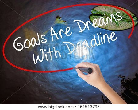 Woman Hand Writing Goals Are Dreams With Deadline With Marker Over Transparent Board
