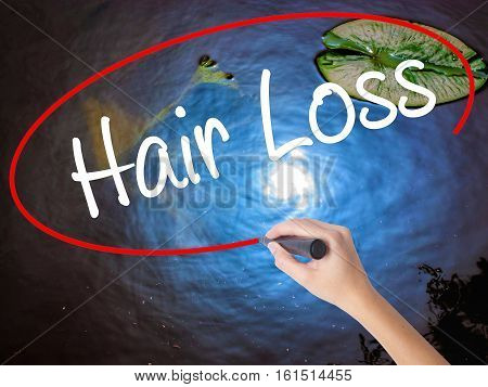 Woman Hand Writing Hair Loss With Marker Over Transparent Board
