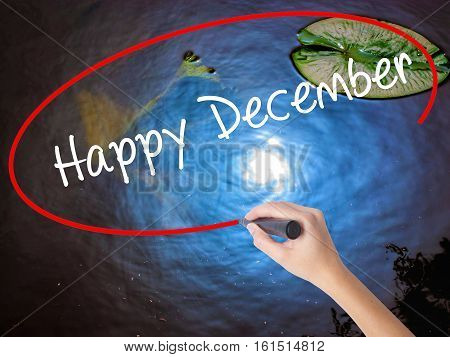Woman Hand Writing Happy December With Marker Over Transparent Board