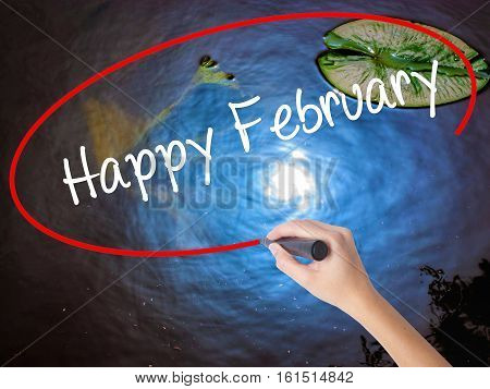 Woman Hand Writing Happy February With Marker Over Transparent Board