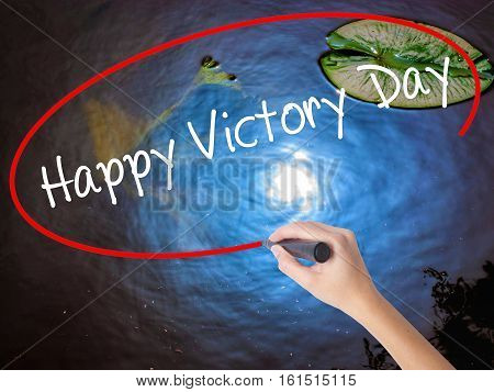 Woman Hand Writing Happy Victory Day With Marker Over Transparent Board.
