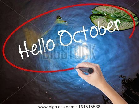 Woman Hand Writing  Hello October  With Marker Over Transparent Board