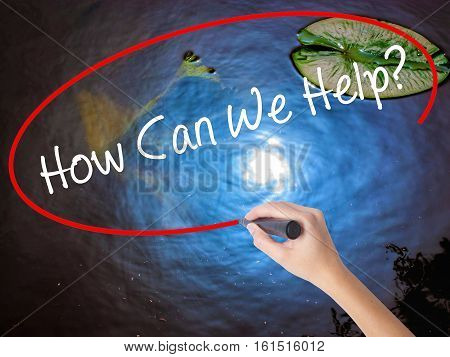 Woman Hand Writing How Can We Help? With Marker Over Transparent Board