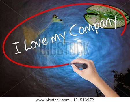 Woman Hand Writing I Love My Company  With Marker Over Transparent Board