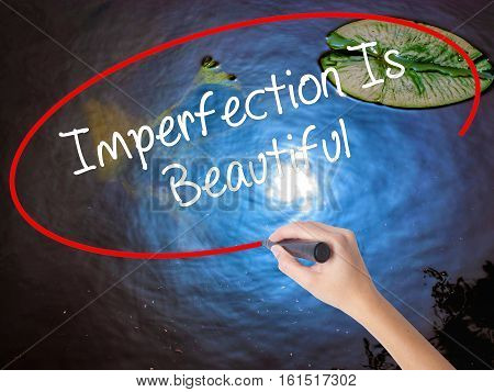 Woman Hand Writing Imperfection Is Beautiful With Marker Over Transparent Board