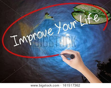 Woman Hand Writing Improve Your Life With Marker Over Transparent Board.