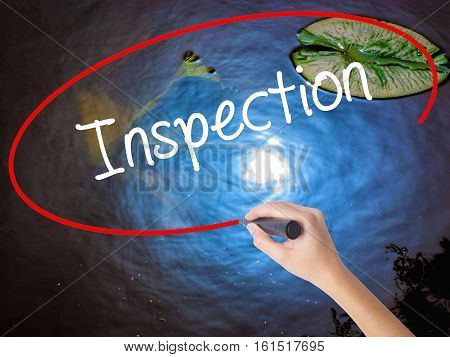 Woman Hand Writing Inspection With Marker Over Transparent Board