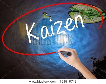 Woman Hand Writing Kaizen With Marker Over Transparent Board