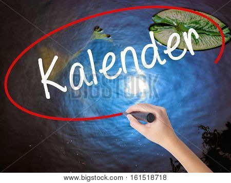 Woman Hand Writing Kalender (calendar In German)  With Marker Over Transparent Board