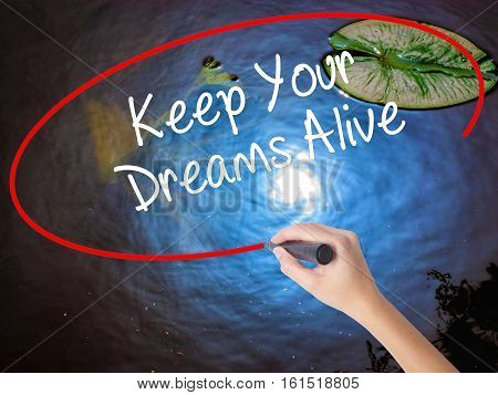 Woman Hand Writing Keep Your Dreams Alive With Marker Over Transparent Board