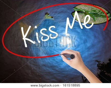 Woman Hand Writing Kiss Me With Marker Over Transparent Board