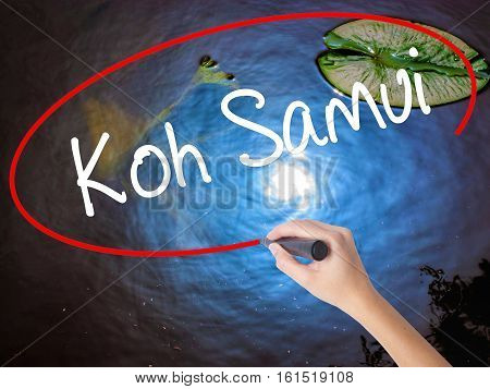 Woman Hand Writing Koh Samui With Marker Over Transparent Board