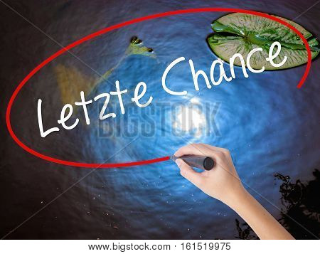 Woman Hand Writing Letzte Chance  (last Chance In German) With Marker Over Transparent Board.