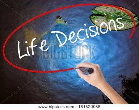 Woman Hand Writing Life Decisions With Marker Over Transparent Board.
