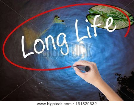 Woman Hand Writing Long Life With Marker Over Transparent Board