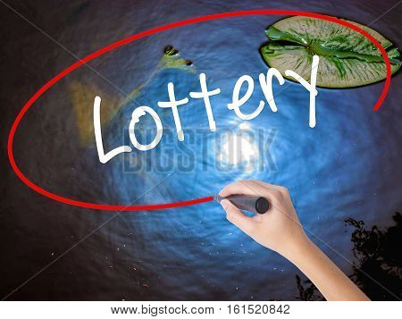 Woman Hand Writing Lottery  With Marker Over Transparent Board